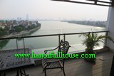 A BEAUTIFUL SPACIOUS THREE-BEDROOM SERVICED APARTMENT FACING TO WESTLAKE ON XUAN DIEU FOR RENT