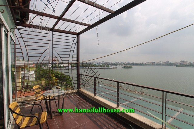 Cozy a 2 bedroom apartment on Nhat Chieu street, great balcony, lake view for rent.