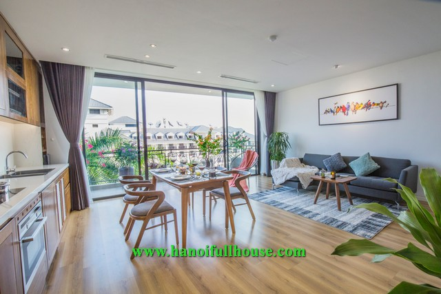 Wonderful apartment in Tu Hoa street, 2 bedrooms, big balcony, facing West Lake for rent.