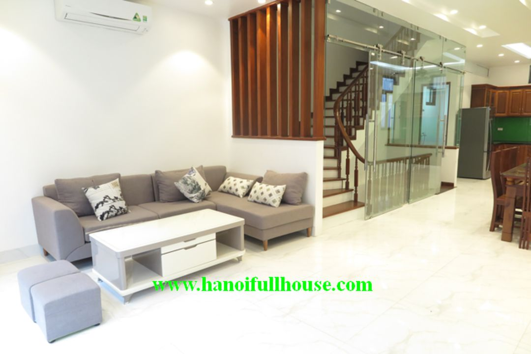 New house on To Ngoc Van street, Quang An dist for rent, 4 closed bedrooms, garage, terrace