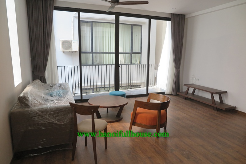 Beautiful apartment in Tay Ho street with balcony, high speed elevator, wooden floor for rent.