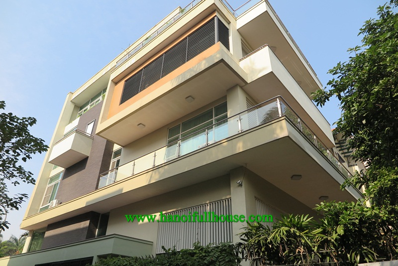 Super nice and modern villa on Dang Thai Mai street, elevator, big balconies and terrace for lease.