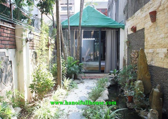 Super strange apartment on Dang Thai Mai street, nice decor with fish tank, garden and trees.